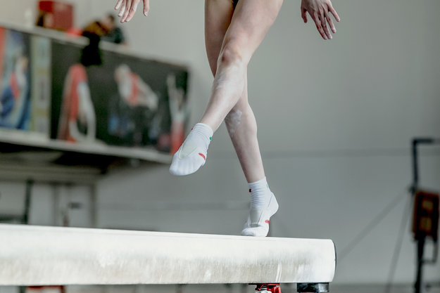 cde4cc701f2a girl gymnast athlete during exercise on balance beam in gymnastics  competitions using the best gym ankle